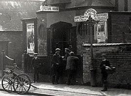 Shipston on Stour Picture House in 1908 with Milepost and its direction board outside